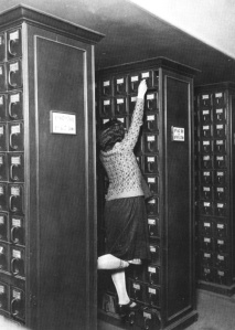 A librarian reaching for the top shelf of the card catalog. | Found on teacoffeebooks.tumblr.com